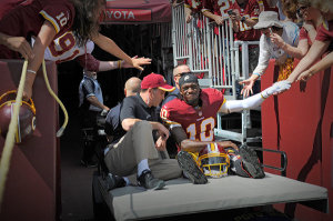 Robert Griffin III had to be carted off of the field on Sunday after dislocating his ankle on a non-contact play. The writing might be on the wall for the Washington Redskins and RGIII's career trajectory.
