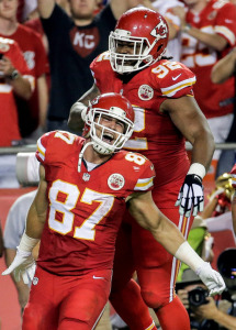 Travis Kelce celebrates after a 2-yard touchdown reception with teammate Dontari Poe, who was in on the play as a 350-pound fullback.
