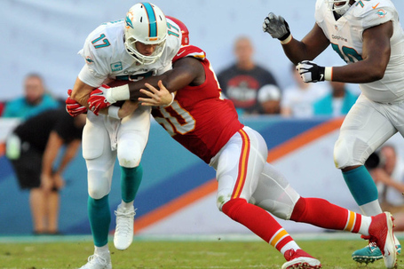 Ryan Tannehill holding on to the ball for dear life as Justin Houston brings him down for a sack after beating La'Wuan James on the play.