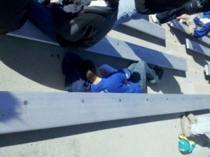 a sleepy KU football fan takes a nap during a football game.